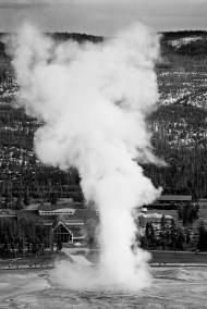 photo of Old Faithful taken from mountain trail, Yellowstone National Park